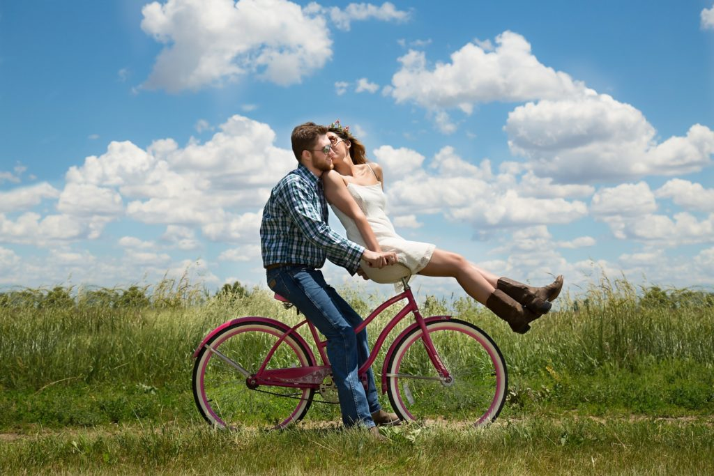 kissing couple on bicycle