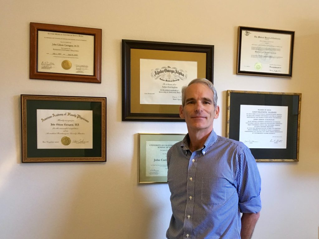 John Curington MD in vasectomy office in Lutz